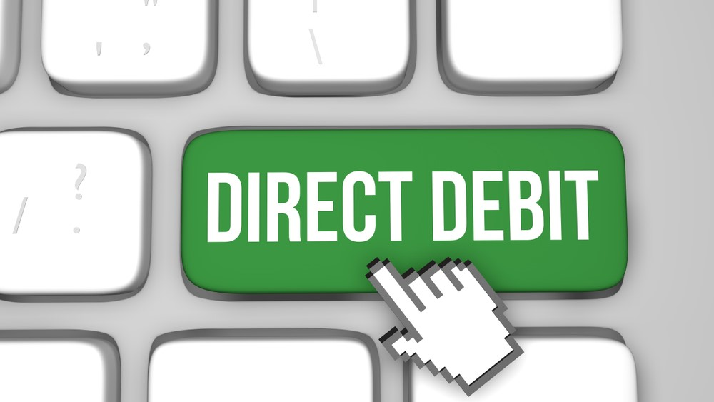 "Graphic depicting a mouse cursor hovering over a green ""Direct Debit"" button. Get lottery tickets online"