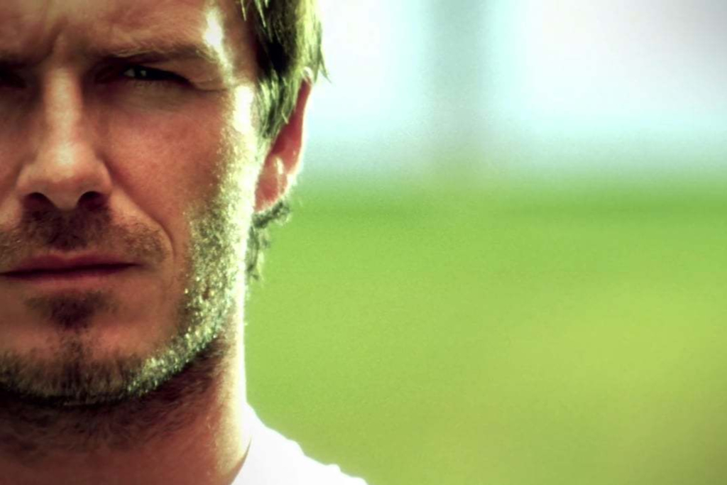 David Beckham with blurred out football pitch background