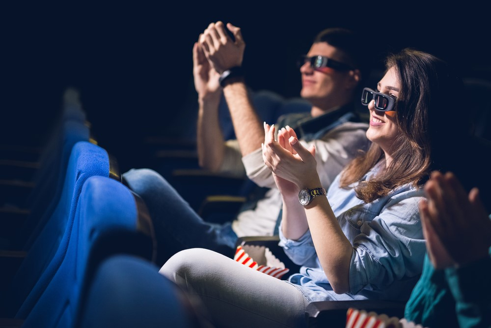 Happy couple watching movie about winning lottery