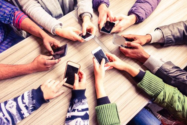 Diverse group of hands using mobile lottery app